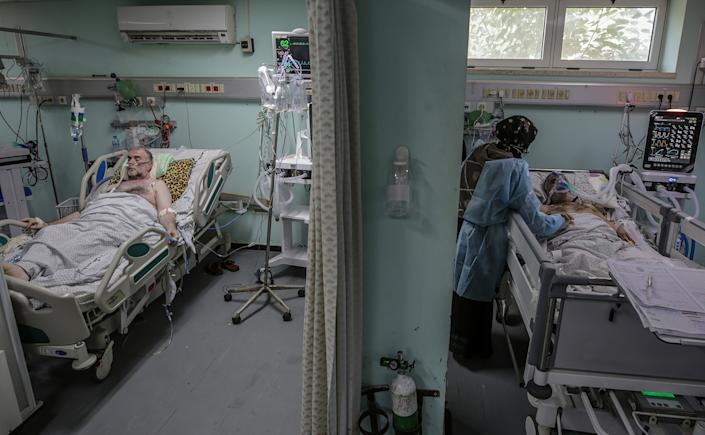 Palestinian patients with coronavirus in the intensive care unit at the European Hospital, east of Rafah town, southern Gaza strip, 30 November 2020. (Mohammed Saber/EPA-EFE/Shutterstock)