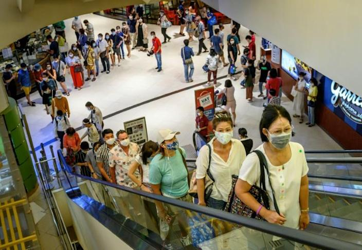 Shoppers flocked to Thailand's top-end malls, eager for retail therapy as shopping centres reopened (AFP Photo/Mladen ANTONOV)