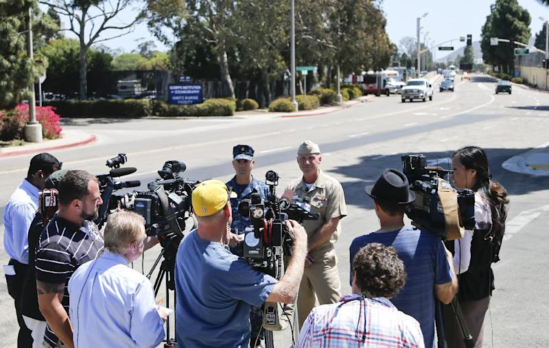 Captain Scott F. Adams, right, Commanding Officer Navy Base Point Loma, accompanied by Lt. Commander Steve Ruh, talks about an incident on the base in which a sailor was arrested for operating an Airsoft weapon on the base, Thursday, April 24, 2014, in San Diego. A second sailor who was a friend of the sailor with the weapon was also arrested. (AP Photo/Lenny Ignelzi)