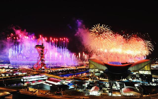 LONDON, ENGLAND - JULY 27: Fireworks over the Olympic Stadium and the Aquatics Arena during the Opening Ceremony at the Olympic Park on July 27, 2012 in London, England. (Photo by Mike Hewitt/Getty Images)