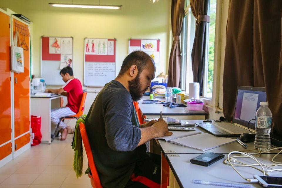 Universiti Teknologi Mara students study in their dormitory room during the third phase of the movement control order in Shah Alam April 22, 2020. — Picture by Yusof Mat Isa