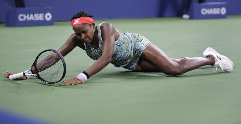 Coco Gauff, of the United States, falls to the court while chasing a shot from Timea Babos, of Hungary, during the second round of the U.S. Open tennis tournament in New York, Thursday, Aug. 29, 2019. (AP Photo/Charles Krupa)