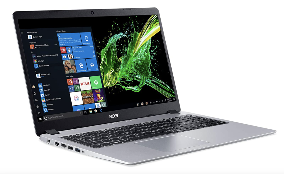 open acer laptop with black and green screen and graphic including netflix and apple itunes