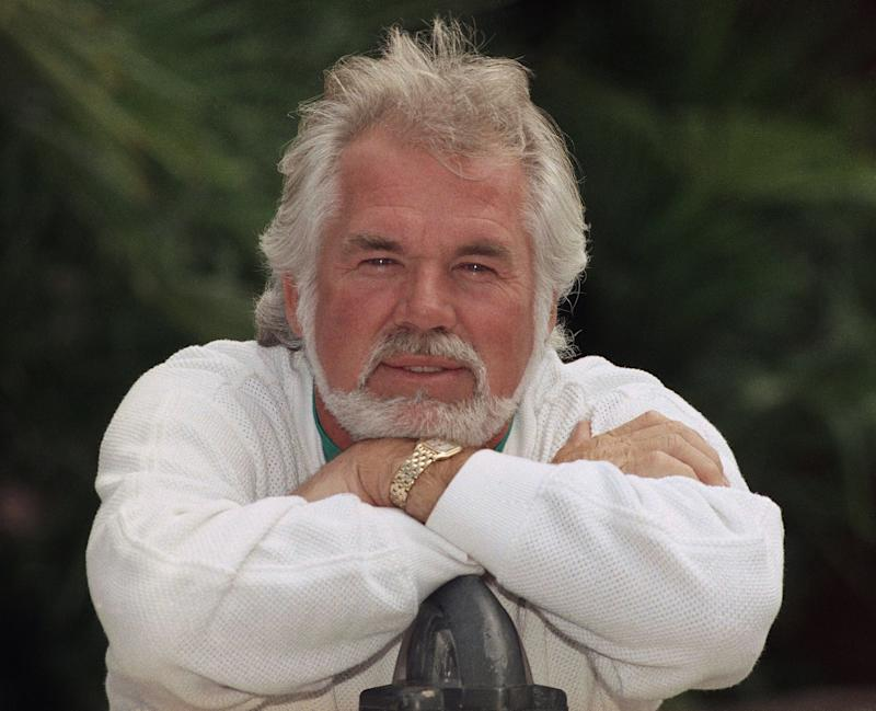 """Kenny Rogers, who died last month at age 81, was honored with a """"CMT Giants"""" tribute special raising money for MusiCares."""