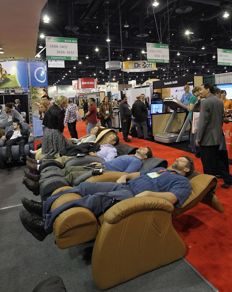 LAS VEGAS, NV - JANUARY 11: Attendees take a break during the 2012 International Consumer Electronics Show at the Las Vegas Convention Center January 11, 2012 in Las Vegas, Nevada. CES, the world's largest annual consumer technology trade show, runs through January 13 and features more than 3,100 exhibitors showing off their latest products and services to about 140,000 attendees.  (Photo by Bruce Bennett/Getty Images)