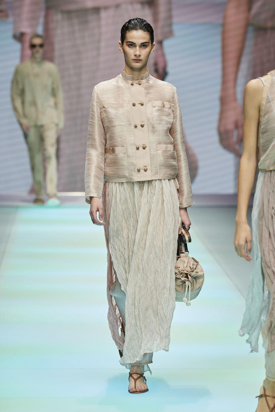 """<p>Celebrating its 40-year anniversary, Emporio Armani showed the men's and women's collections together for SS22, one which was entitled 'Elsewhere'.</p><p>""""Under the symbol of an eagle that flies high and knows no<br>boundaries, for forty years, Emporio Armani has been<br>expressing the joys of fashion free from imposed rules, that nevertheless maintains the harmony of shapes, balance, and the sense of nonchalant elegance that are the essence of Armani style,"""" the show notes read. """"This season, the journey begins in an imaginary desert, crossing its oasis and ending in vibrant colourways. Everything blends together, quite freely.""""</p>"""