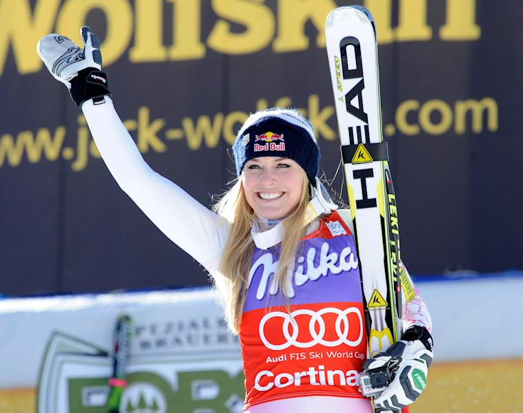 FILE - In this Saturday, Jan. 19, 2013 file photo, Lindsey Vonn, of the United States, celebrates at the finish area after winning an Alpine Ski World Cup women's downhill, in Cortina D'Ampezzo, Italy. Lindsey Vonn has won her sixth straight World Cup downhill title after thick fog forced the scheduled final race to be cancelled on Wednesday March 13, 2013. Five weeks after her season was ended by a serious knee injury, Vonn has retained her title by a single point from Tina Maze of Slovenia. (AP Photo/Giovanni Auletta, File)
