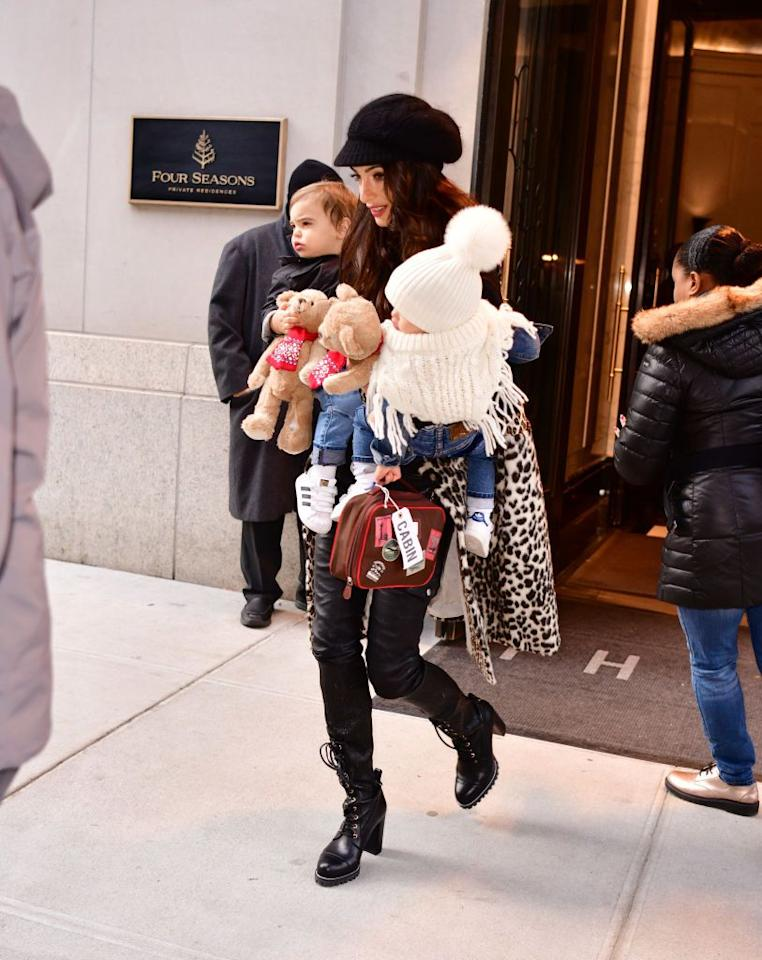 <p>Amal looks casual chic in a cheetah print coat, black leather pants, lace up boots, and a black cap as she leaves the Four Seasons Hotel with twins Alexander and Ella Clooney. </p>