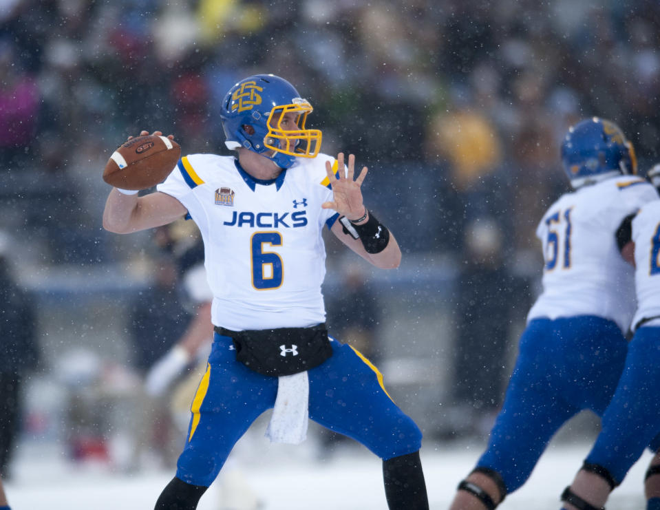 In this photo provided by Montana State University, South Dakota St quarterback Austin Sumner (6) makes a pass in the first half of an NCAA Football Championship Subdivision playoff game Saturday, Nov. 29, 2014, in Bozeman, Mont. (AP photo/Kelly Gorham)