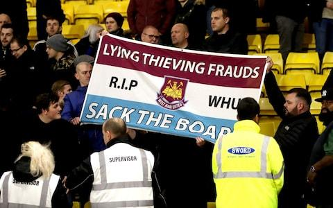 West Ham fans with a banner - Credit: PA
