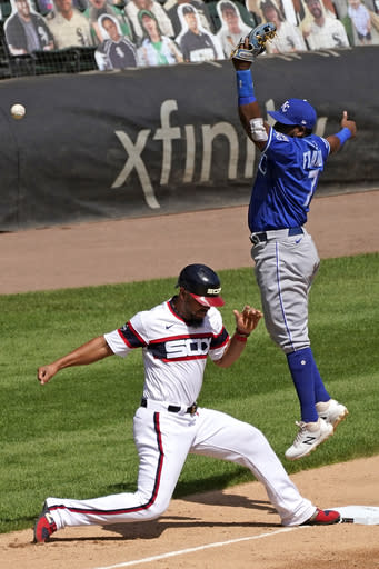 Chicago White Sox's Jose Abreu, left, is safe at third after James McCann hit a one-run double as Kansas City Royals third baseman Maikel Franco misses the catch during the third inning of a baseball game in Chicago, Sunday, Aug. 30, 2020. (AP Photo/Nam Y. Huh)