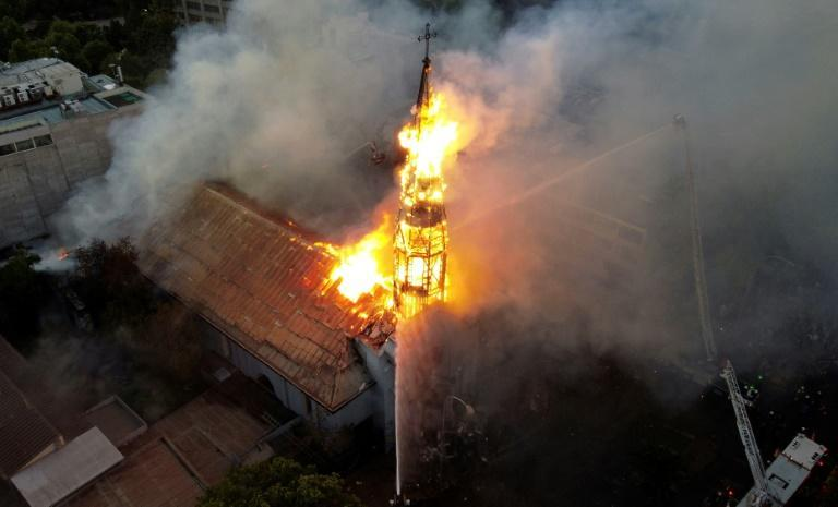 Aerial view of the church of the Assumption in flames after violence broke out during protests in Santiago Sunday