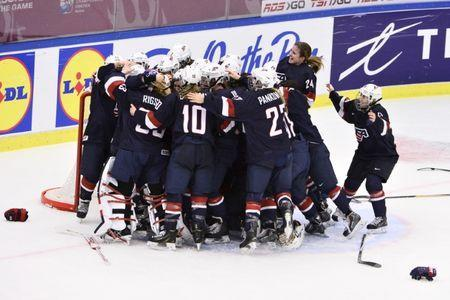 Team USA players react on winning the 2015 IIHF Ice Hockey Women's World Championship gold medal match between USA and Canada at Malmo Isstadion in Malmo, southern Sweden, on April 4, 2015. REUTERS/Claudio Bresciani/TT News Agency