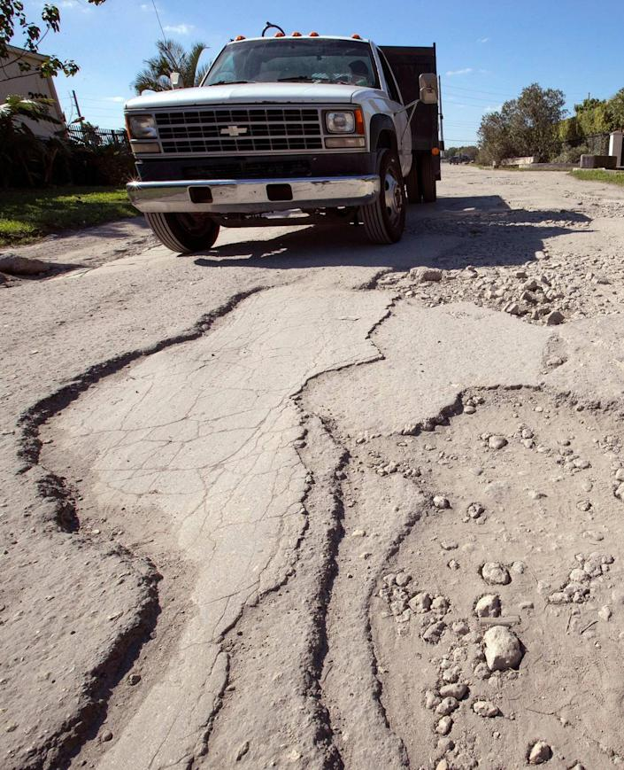 """Jonathan Loredo, who works at Best Motors, said he wrote to President Donald Trump about the bad roads. """"It's the United States, you expect things to get fixed, but not here."""""""