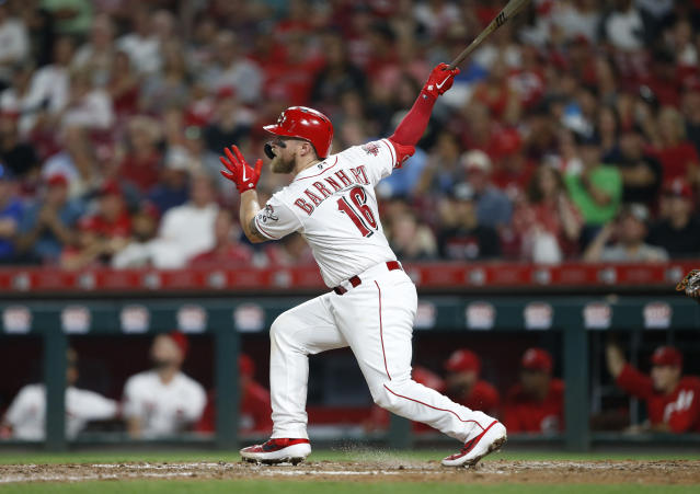 Cincinnati Reds' Tucker Barnhart follows through on a solo home run off Los Angeles Angels relief pitcher Justin Anderson during the sixth inning of a baseball game Tuesday, Aug. 6, 2019, in Cincinnati. (AP Photo/Gary Landers)