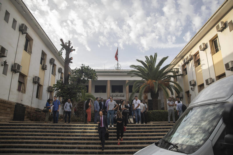 Lawyers and relatives walk outside the court where journalist Hajar Rissouni is being tried on accusations of undergoing an illegal abortion, in Rabat, Morocco, Monday, Sept. 30, 2019.  The 28-year old Moroccan journalist Hajar Raissouni was sentenced to one year in prison, Monday, while her fiancé also received a one-year sentence and the doctor accused of terminating the pregnancy was sentenced to two years in jail and suspended from practicing.  (AP Photo/Mosa'ab Elshamy)