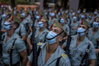 Members of La Legion, an elite unit of the Spanish Army, wait for the start of a military parade celebrating a holiday known as 'Dia de la Hispanidad' or Hispanic Day in Madrid, Spain, Tuesday, Oct. 12, 2021. Spain commemorates Christopher Columbus' arrival in the New World and also Spain's armed forces day. (AP Photo/Manu Fernandez)