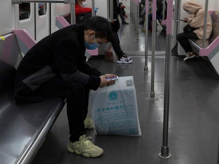 A passenger takes the subway in Wuhan on April 1, 2020.