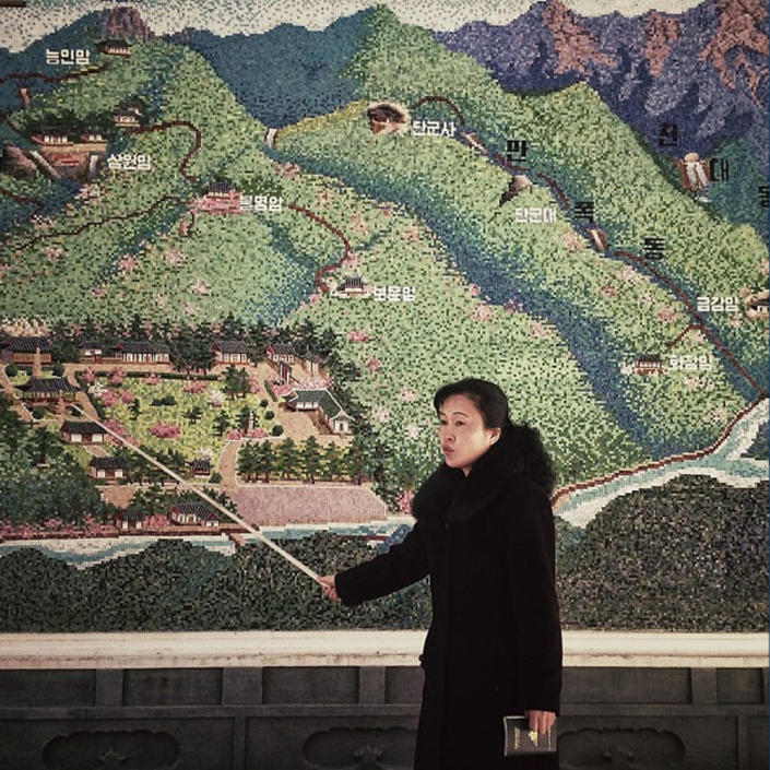 In this Sunday, Feb. 24, 2013 photo posted to Instagram on Monday, Feb. 25, 2013, a North Korean guide uses a pointer at the start of a tour of an historic site in Pyongyang. (AP Photo/David Guttenfelder)