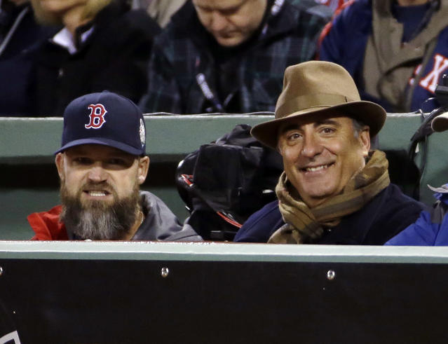 Actor Andy Garcia, right, watches alongside Boston Red Sox catcher David Ross, left, during the second inning of Game 2 of baseball's World Series between the Red Sox and the St. Louis Cardinals Thursday, Oct. 24, 2013, in Boston. (AP Photo/Matt Slocum)