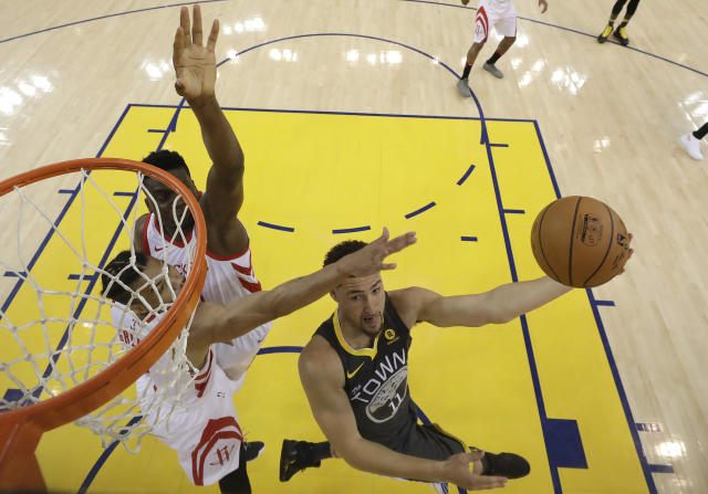 Golden State Warriors guard Klay Thompson (11) shoots against the Houston Rockets during the first half in Game 4 of the NBA basketball Western Conference Finals Tuesday, May 22, 2018, in Oakland, Calif. (AP Photo/Marcio Jose Sanchez, Pool)