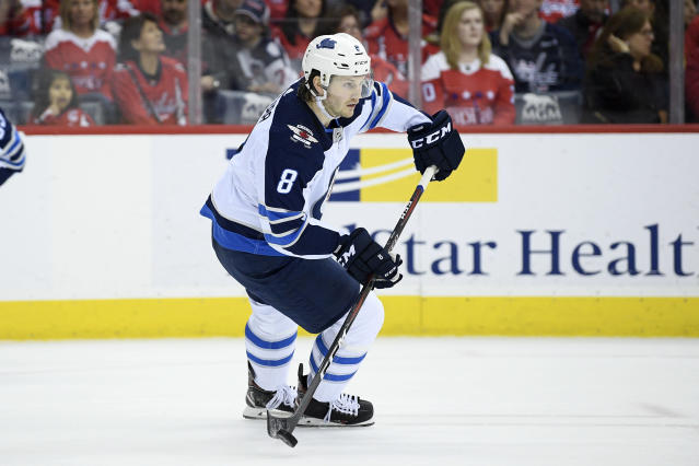 FILE - In this March 10, 2019, file photo, Winnipeg Jets defenseman Jacob Trouba (8) skates with the puck during the first period of an NHL hockey game against the Washington Capitals in Washington. Mitch Marner, Brayden Point and Jacob Trouba are among a bumper crop of restricted free agents. Every NHL team in the league would like to add any of those players to its roster. However, it will register as a big surprise in if any team tries to sign them away. (AP Photo/Nick Wass, File)