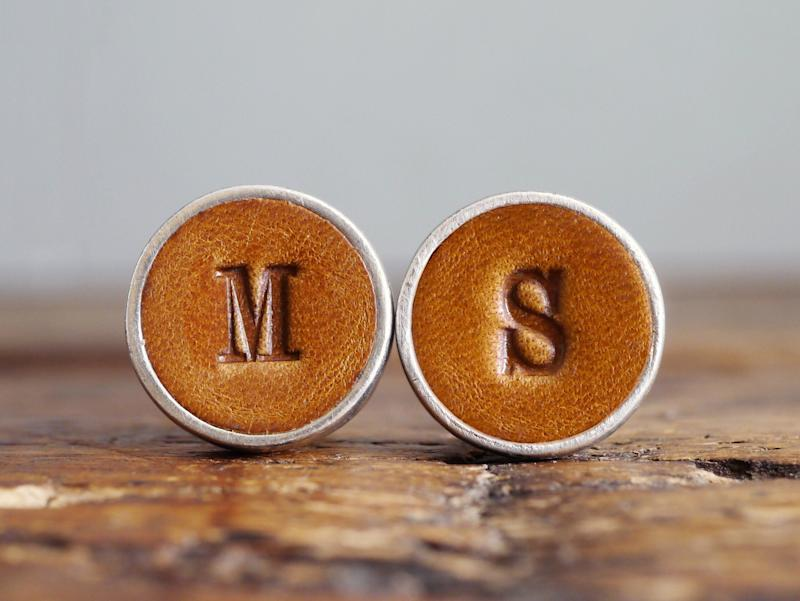 """Choose an initial letter for each of these custom cufflinks. Perfect for the dapper dresser in your life.&nbsp;<a href=""""https://fave.co/3ac7WHS"""" target=""""_blank"""" rel=""""noopener noreferrer"""">Find it for $68 on Etsy</a>."""
