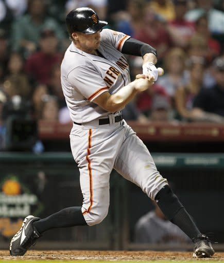 San Francisco Giants' Hunter Pence (8) hits a single to score two runs in the seventh inning against the Houston Astros during a baseball game, Thursday, Aug. 30, 2012, in Houston. (AP Photo/Patric Schneider)