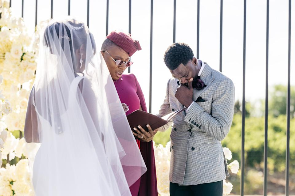 Aisha praying over our rings as we exchange our vows.