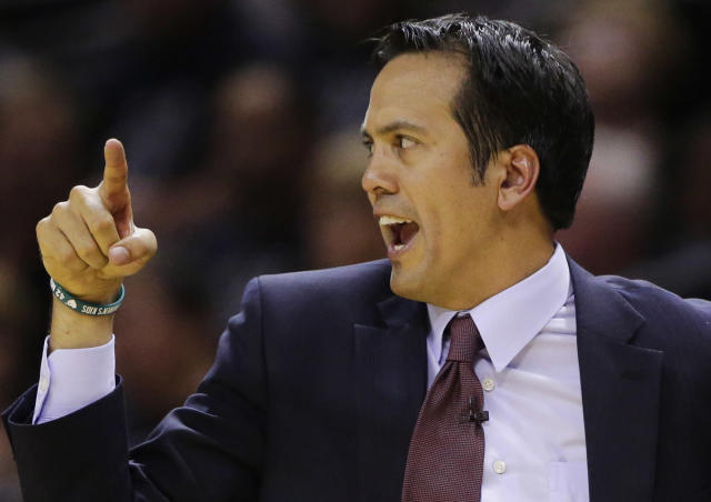 Miami Heat head coach Erik Spoelstra shouts from the sideline against the San Antonio Spurs during the first half in Game 1 of the NBA basketball finals on Thursday, June 5, 2014, in San Antonio. (AP Photo/Eric Gay)