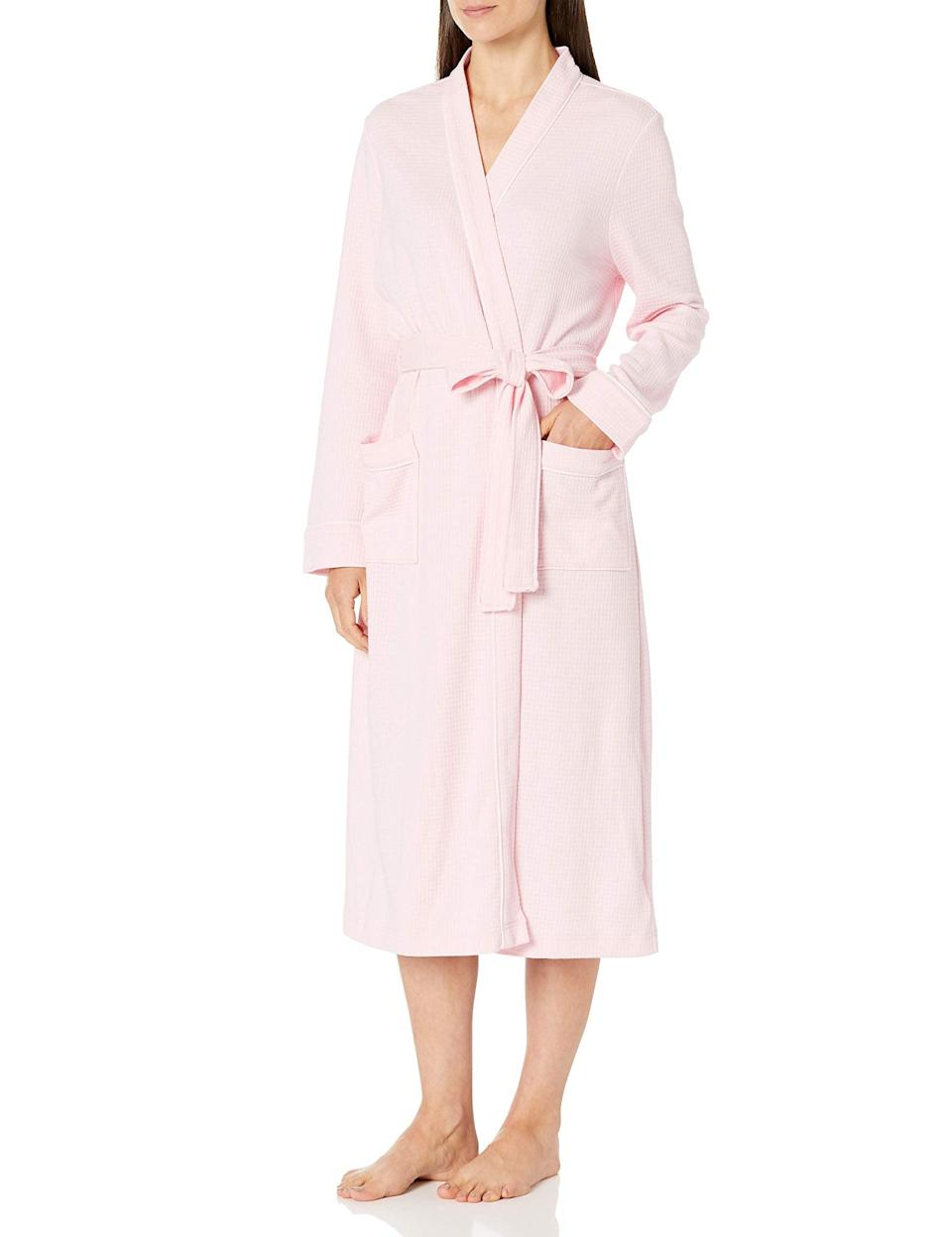 """<h3>Lightweight Cotton Robe</h3><br>Gift mom a lightweight, natural cotton robe she can lounge in all spring through summer long.<br><br><strong>Rating: </strong>4.7 out of 5 stars, and 2,333 reviews<br><br><strong>A Satisfied Customer Review: </strong>""""Love this robe. Quality fabric... excellent construction and really nice style. The sleeves stay out of the way while getting ready. That is so helpful. The sleeves of my old robe always seem to get wet in the sink.""""<br><br><strong>Amazon Essentials</strong> Lightweight Waffle Full-Length Robe, $, available at <a href=""""https://amzn.to/3sBFZku"""" rel=""""nofollow noopener"""" target=""""_blank"""" data-ylk=""""slk:Amazon"""" class=""""link rapid-noclick-resp"""">Amazon</a>"""