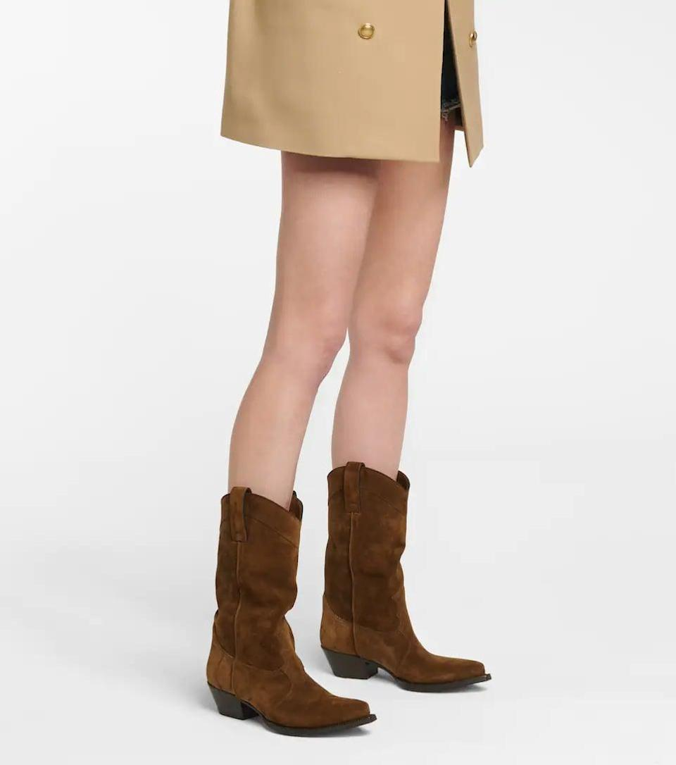 <p>If you feel like treating yourself, go with these stunning <span>Saint Laurent Lukas Western Suede Boots</span> ($1,195). They come in a few different colors, but the chocolate brown suede is a winner to us.</p>