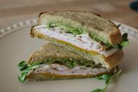 """<p><strong>Turkey and Green Chile Sandwich</strong></p><p>New Mexico is known for green chiles, and puts them to good use in their Turkey and Green Chile Sandwich. At restaurant <a href=""""https://www.relishsandwichesabq.com/"""" rel=""""nofollow noopener"""" target=""""_blank"""" data-ylk=""""slk:Relish"""" class=""""link rapid-noclick-resp"""">Relish</a>, the sandwich features turkey, havarti, chile and chipotle mayo on toasted sourdough. Other topping options on this perfect lunch includes green apple chile chutney, avocado and muenster cheese.</p>"""