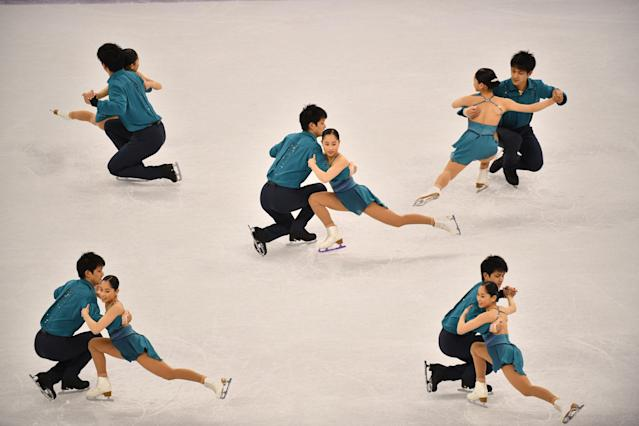 <p>A multiple exposure shows Japan's Miu Suzaki and Japan's Ryuichi Kihara competing in the pair skating short program of the figure skating event during the Pyeongchang 2018 Winter Olympic Games at the Gangneung Ice Arena in Gangneung on February 14, 2018. / AFP PHOTO / Mladen ANTONOV </p>