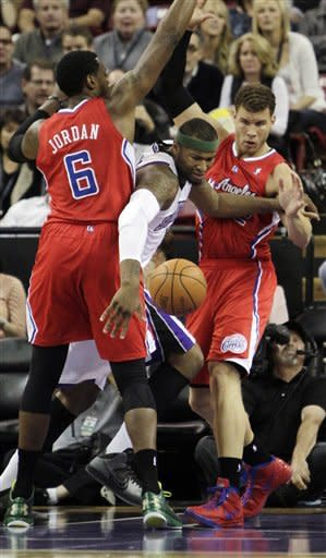 Sacramento Kings center DeMarcus Cousins, center, battles for the ball with Los Angeles Clippers' DeAndre Jordan, left, and Blake Griffin during the first quarter of an NBA basketball game in Sacramento, Calif., Thursday, April 5, 2012. (AP Photo/Rich Pedroncelli)