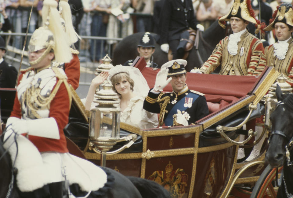 Charles, Prince of Wales, and his wife, Princess Diana (1961 - 1997), wave to the crowds following their wedding ceremony at St Paul's Cathedral, London, UK, 29th July 1981. (Photo by Princess Diana Archive/Hulton Royals Collection/Getty Images)