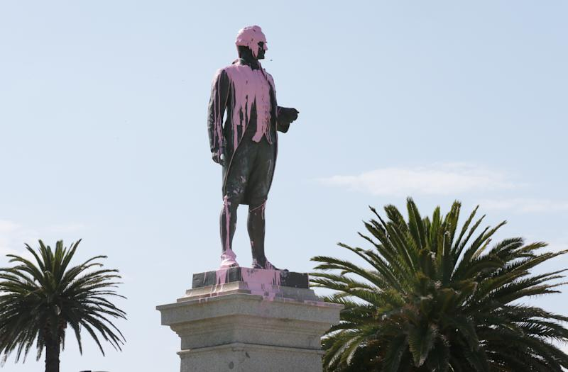 Pink paint is seen covering the head of the James Cook statue in St Kilda, Melbourne, Thursday in 2018. Cook has become a divisive figure in the current culture wars. Source: AAP