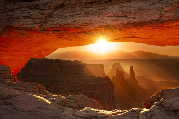 Canyonlands National Park, Utah - This was one of the most amazing sunrises I've ever seen. The sun broke over the mountains, the light filled the valley and the arch took care of the rest! © World Wildlife Fund/Steve Perry