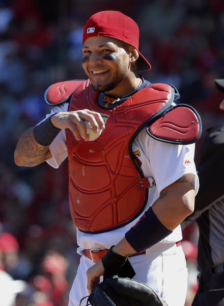 St. Louis Cardinals catcher Yadier Molina laughs after a ball somehow got stuck to his chest protector on a dropped third strike during the seventh inning of a baseball game against the Chicago Cubs on Thursday, April 6, 2017, in St. Louis. The ball was stuck to Molina's chest protector after the Cubs' Matt Szczur struck out swinging allowing Szczur to reach first base when Molina couldn't find the ball. (AP Photo/Jeff Roberson)