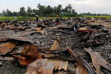 FILE PHOTO -  The ruins of a market which was set on fire are seen at a Rohingya village outside Maugndaw in Rakhine state