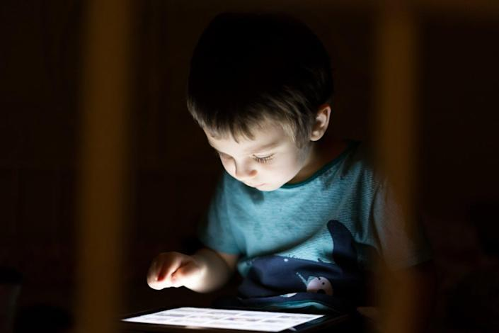 """<span class=""""caption"""">Blue light from tablets can make it hard to fall asleep.</span> <span class=""""attribution""""><a class=""""link rapid-noclick-resp"""" href=""""http://www.shutterstock.com/pic-252645337/stock-photo-kid-with-tablet-in-the-dark-laying-in-bed-and-reading.html?src=8zDvwa9AeHYFUU4Wl-dpVQ-1-62"""" rel=""""nofollow noopener"""" target=""""_blank"""" data-ylk=""""slk:Boy with tablet via www.shutterstock.com"""">Boy with tablet via www.shutterstock.com</a></span>"""