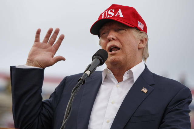 <p>FILE – In this Saturday, Dec. 17, 2016 file photo, President-elect Donald Trump speaks during a rally at Ladd-Peebles Stadium in Mobile, Ala. On Saturday, Dec. 16, 2017, several people familiar with Trump's transition organization say special counsel Robert Mueller's team has gained access to thousands of private emails sent and received by Trump officials before the start of his administration. (AP Photo/Evan Vucci) </p>