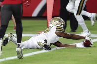 New Orleans Saints wide receiver Emmanuel Sanders (17) carries the football over the goal line after a 12-yard touchdown reception from quarterback Drew Brees during the first half of an NFL football game against the Tampa Bay Buccaneers Sunday, Nov. 8, 2020, in Tampa, Fla. (AP Photo/Mark LoMoglio)