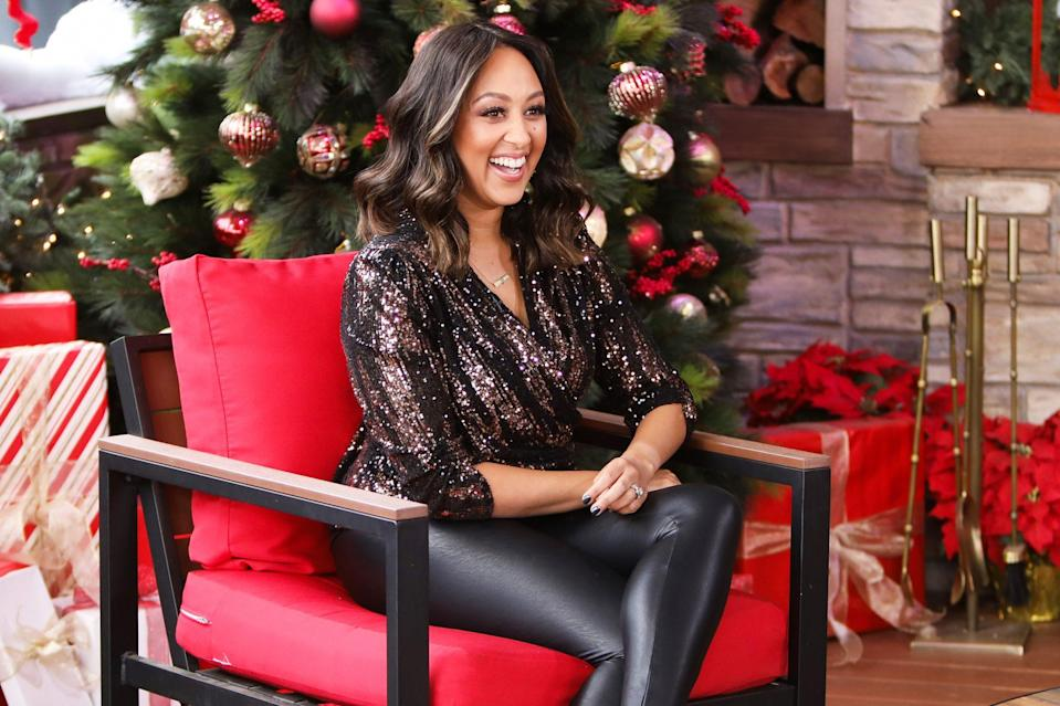 "<p>Tamera Mowry-Housley spreads some Christmas cheer at Hallmark Channel's ""Home & Family"" in L.A. on Monday. </p>"
