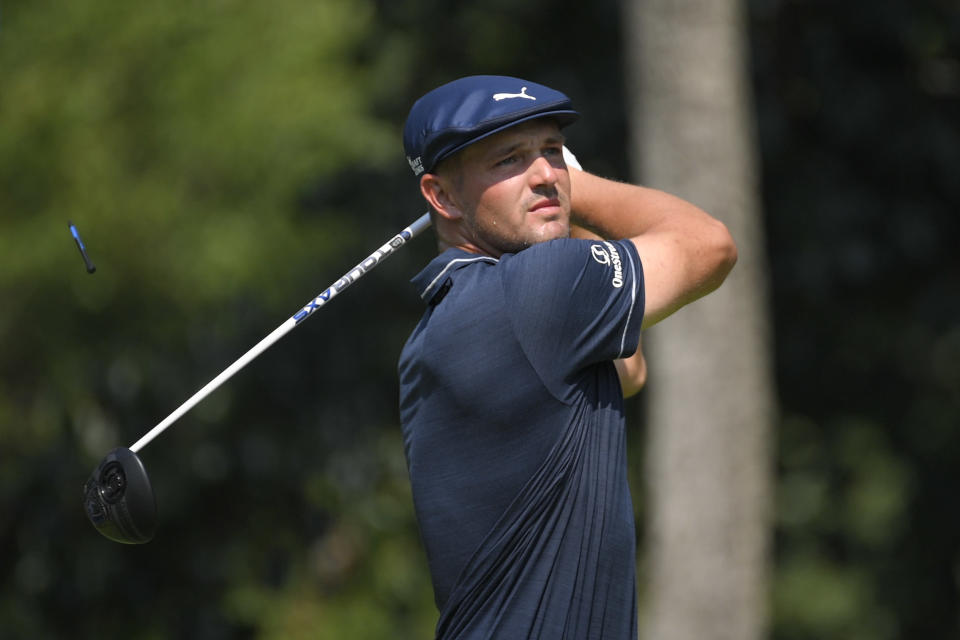Bryson DeChambeau tees off from the second hole during the second round of the BMW Championship golf tournament, Friday, Aug. 27, 2021, at Caves Valley Golf Club in Owings Mills, Md. (AP Photo/Nick Wass)