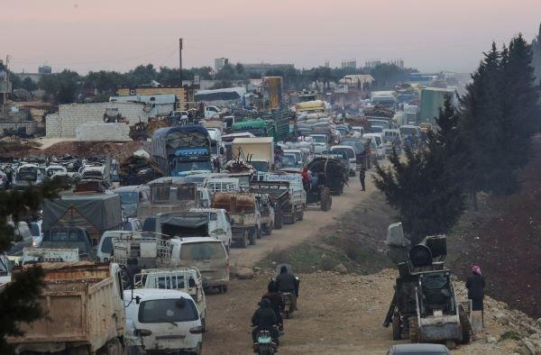 A general view of trucks carrying belongings of displaced Syrians, is pictured in the town of Sarmada in Idlib province, Syria, January 28, 2020. Via REUTERS/Khalil Ashaw