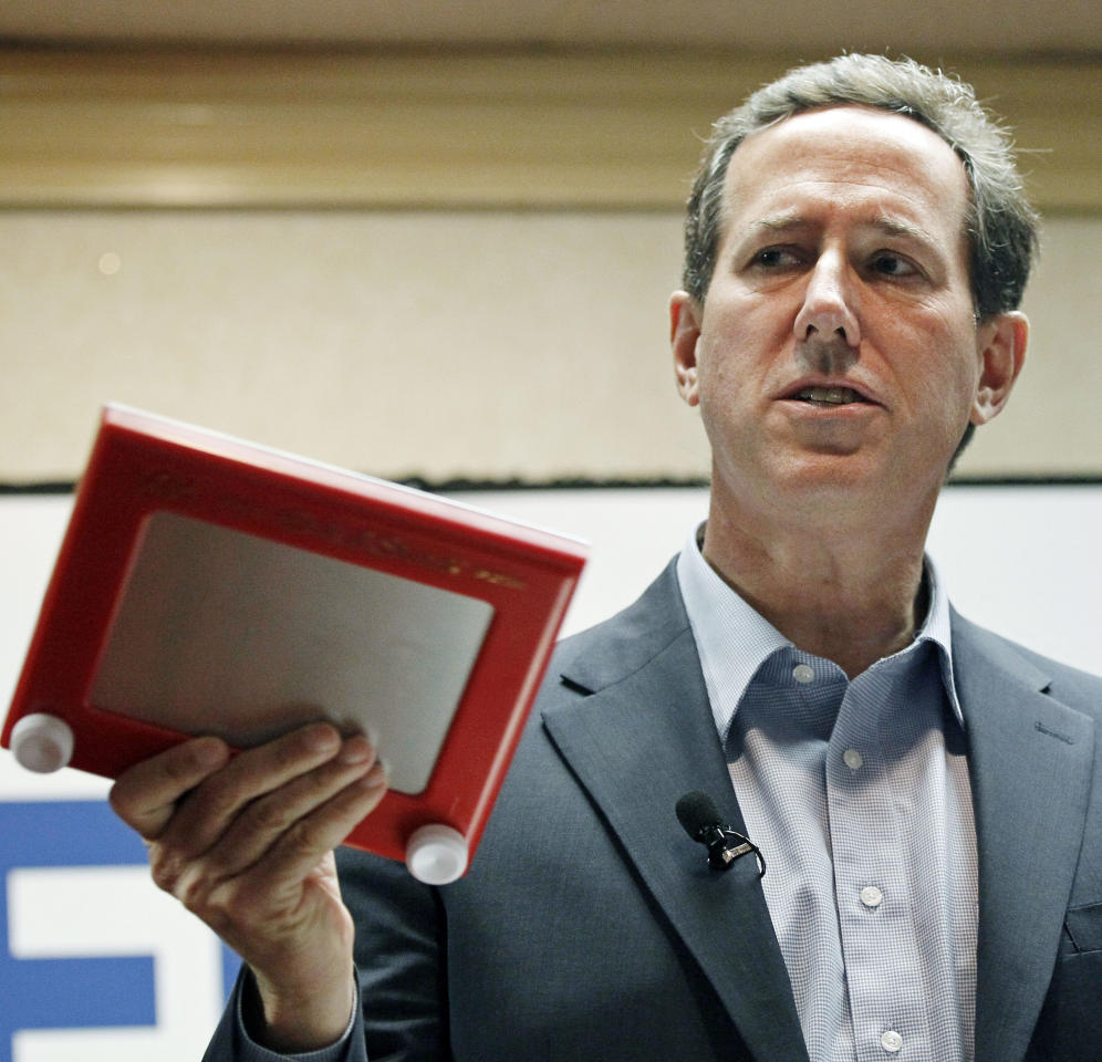 Republican presidential candidate former Pennsylvania Sen. Rick Santorum, waves a Etch-A-Sketch while criticizing the policies of GOP presidential candidate Mitt Romney at a rally in Shreveport, La., Friday, March 23, 2012. Santorum has strong support among many conservative voters in the state which his campaign hopes results in winning Louisiana's primary on Saturday. (AP Photo/Rogelio V. Solis)