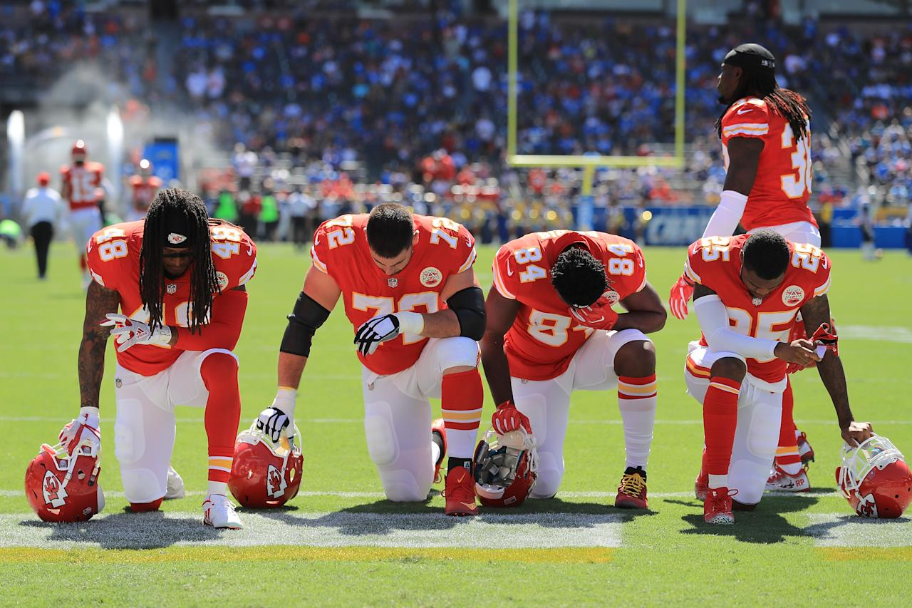<p>Terrance Smith #48, Eric Fisher #72, Demetrius Harris #84, and Cameron Erving #75 of the Kansas City Chiefs is seen taking a knee before the game against the Los Angeles Chargers at the StubHub Center on September 24, 2017 in Carson, California. (Photo by Sean M. Haffey/Getty Images) </p>