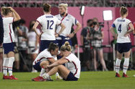 <p>United States' Kelley O'Hara, left, talks to teammate Lindsey Horan after being defeated 1-0 by Canada during a women's semifinal soccer match at the 2020 Summer Olympics, Monday, Aug. 2, 2021, in Kashima, Japan.(AP Photo/Andre Penner)</p>