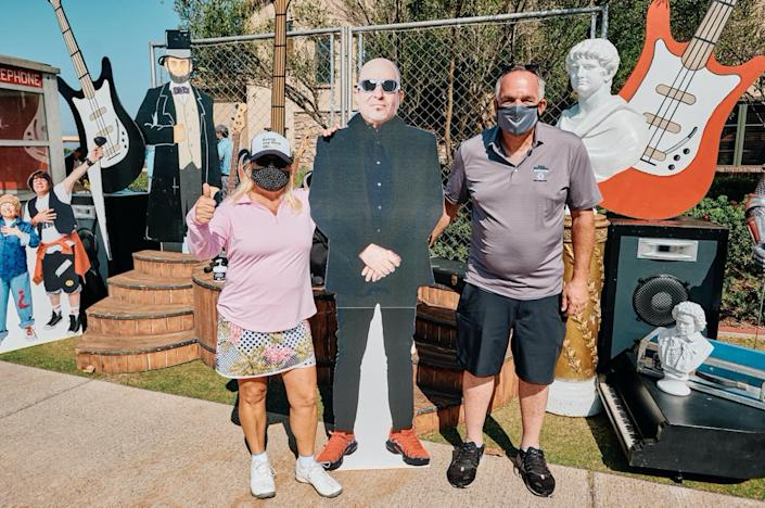 Tilly and Tillys CEO, Ed Thomas, pose with one of the many movie-inspired cutouts of Tillys Co-Founder, Hezy Shaked, depicted in the role of Rufus.: Tilly's Photo